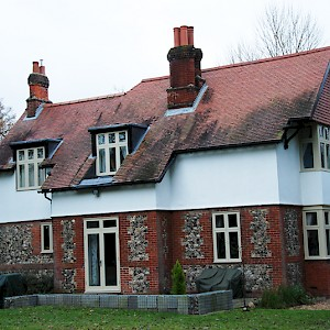 Red brick house with replacement timber windows, Norfolk