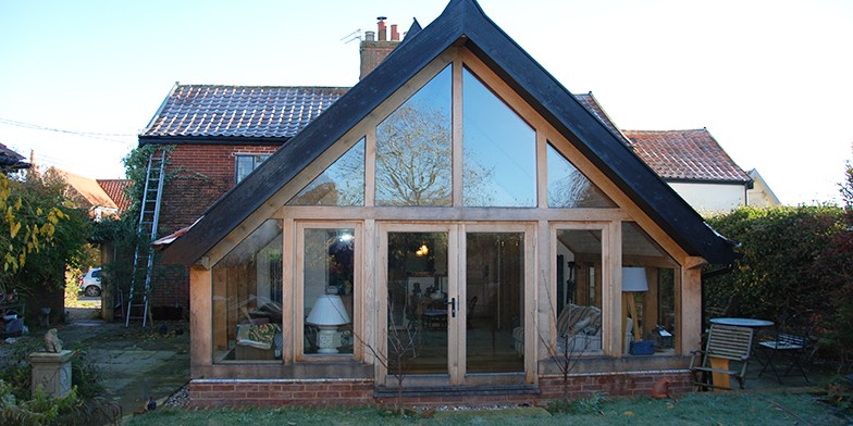 The creation of the large glazed gable frame brings the outside in.