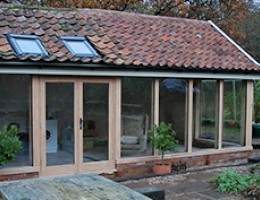 Oak Garden room extension with Velux windows, Norfolk